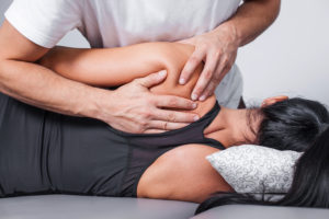 Body massage in spa. Physiotherapy back pain exercises.